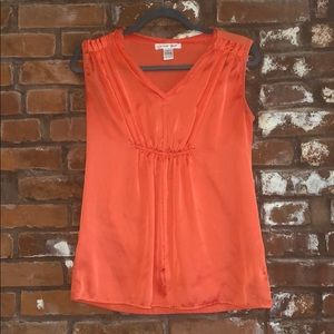 Orange cap sleeve shirt